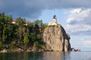 Lighthouse on top of cliffside overlooking Lake Superior