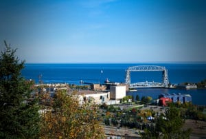 Lake Superior is seen beyond the iconic Duluth, Minnesota Aerial Lift Bridge, things to do in Duluth