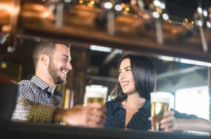 Young couple enjoying beer at a pub, fun things to do in Duluth