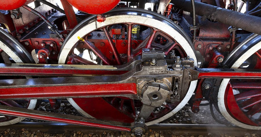 Red wheels of a steam train locomotive at Duluth train museum