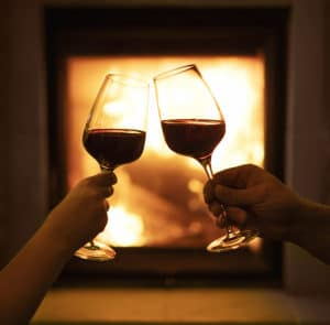 Two glasses of wine on the background of the fireplace, at the best places to stay in Duluth MN